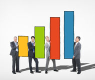 Group of Business People Holding Bar Graph Stock Photos