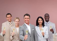 Group of business people holding champagne in front of rose background. Digital composite of Group of business people holding champagne in front of rose Stock Photos