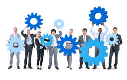 Group of Business People Holding Gear Stock Images