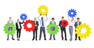 Group of Business People Holding Gear Symbol Royalty Free Stock Photo