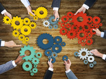 Group of Business People Holding Gears Stock Images