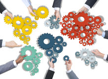 Group of Business People Holding Gears Royalty Free Stock Images