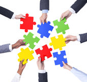 Group of Business People Holding Jigsaw.  Royalty Free Stock Photo