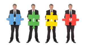 Group of business people holding jigsaw puzzle. Isolated on white Stock Image