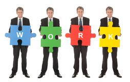 Group of business people holding jigsaw puzzle. Isolated on white Royalty Free Stock Photo