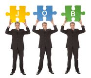 Group of business people holding jigsaw puzzle. Isolated on white Stock Images