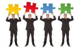 Group of business people holding jigsaw puzzle Royalty Free Stock Photo