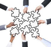 Group Of Business People Holding Pieces Of Puzzle Stock Images