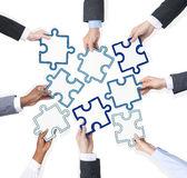 Group Of Business People Holding Pieces Of Puzzle Royalty Free Stock Photography