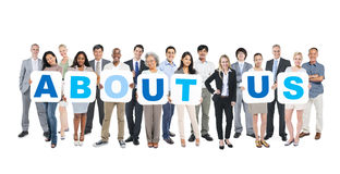 Group Of Business People Holding About Us.  Royalty Free Stock Photos