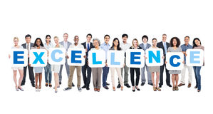 Group Of Business People Holding The Word Excellence.  stock photos