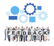 Group of Business People Holding Word Feedback. Multi-Ethnic Group of Diverse People Holding Letters To Form A Feedback royalty free stock photography