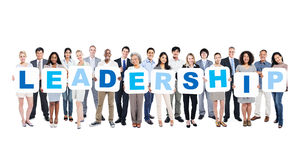 Group Of Business People Holding The Word Leadership stock photography