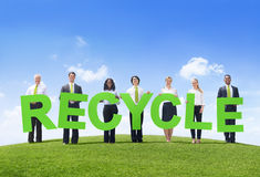 Group of Business People Holding Word Recycle.  Royalty Free Stock Image
