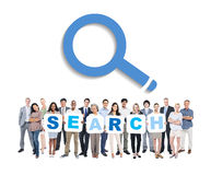Group of Business People Holding Word Search. Multi-Ethnic Group Of Business And Casual People Holding Placards With Letters That Forms Search royalty free stock photo