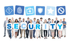 Group of Business People Holding Word Security Stock Images