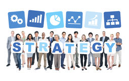 Group Of Business People Holding Word Strategy Royalty Free Stock Photo