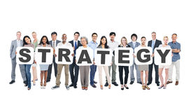 Group Of Business People Holding Word Strategy Stock Photos