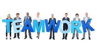 Group of Business People Holding Word Teamwork Stock Photos