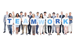 Group of Business People Holding Word Teamwork Royalty Free Stock Photography