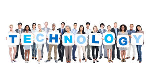 Group Of Business People Holding Word Technology. Group Of Business People Holding The Word Technology Stock Photos