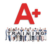 Group of Business People Holding Word Training Stock Photography