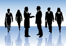 Group of business people interacting. Group of male and female business people in silhouettes on blue background, walking forward, a woman and a man talking to Royalty Free Stock Photography