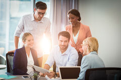 Group of business people interacting using digital tablet. In the office Stock Photo