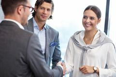 Group of business people introducing one another stock photography