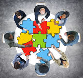 Group of Business People with Jigsaw Photo Illustration Stock Photos