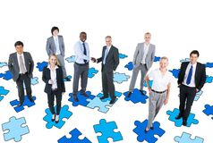 Group of Business People with Jigsaw Puzzle royalty free stock photos