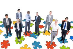 Group of Business People with Jigsaw Puzzle Royalty Free Stock Image