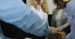 Group of business people join hands together in creative modern office, successful businesspeople team cheering concept. Slow motion 60 stock video footage