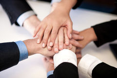 Group of business people joining hands Stock Photos
