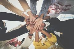 Group of business people joining hands. Team work concept. Stock Photography