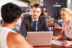 Group of business people with laptop meeting in coffee shop Royalty Free Stock Photo