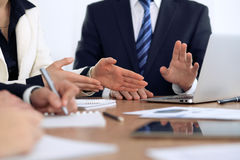 Group of business people and lawyers discussing contract papers Stock Images