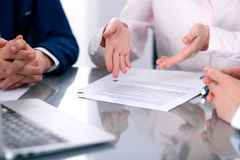 Group of business people and lawyers discussing contract papers. Sitting at the table, close up Stock Photography