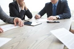 Business people discussing contract Royalty Free Stock Image