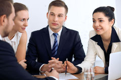 Group of business people and lawyers discussing contract papers Stock Photos