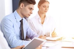 Group of business people or lawyers discussing terms of transaction in office. Meeting and teamwork concept.  stock photography