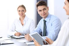 Group of business people or lawyers discussing terms of transaction in office. Meeting and teamwork concept.  stock photos