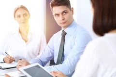Group of business people or lawyers discussing terms of transaction in office. Meeting and teamwork concept.  stock photo