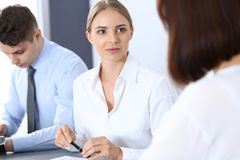 Group of business people or lawyers discussing terms of transaction in office. Meeting and teamwork concept.  stock image