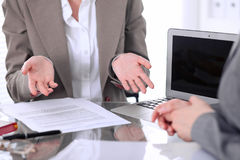 Group of business people or lawyers at meeting discussing contract papers. Woman showing that she do not understand ho stock image