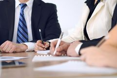 Group of business people or lawyers at meeting, hands close-up.  royalty free stock image