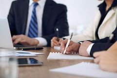 Group of business people or lawyers at meeting, hands close-up.  royalty free stock photo