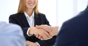 Group of business people or lawyers shaking hands finishing up a meeting , close-up. Success at negotiation and royalty free stock photo