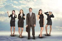 Group of business people with leader on foreground Royalty Free Stock Photos