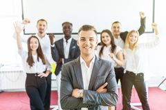 Group of business people with leader at front. Business team celebrate achieved goals while leader standing in front with crossed royalty free stock image